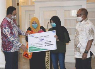 BPJAMSOSTEK Bayarkan Santunan 454 Juta untuk Dua Anggota PPSU Meninggal Saat Bekerja Dengan Disaksikan Gubernur Jakarta